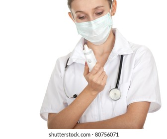 lady doctor in protective glasses and mask, white uniform, with stethoscope holding thermometer