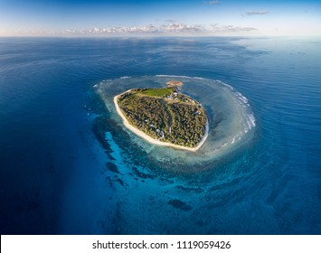 Lady Elliot Island and its coral reef viewed from the sky at sunset