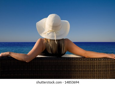 Lady enjoying a perfect view to the ocean