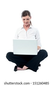 Lady executive working on laptop, studio shot.