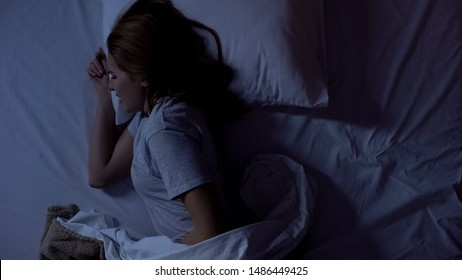 Lady feeling sharp stomachache during sleeping, suffering from cystitis illness