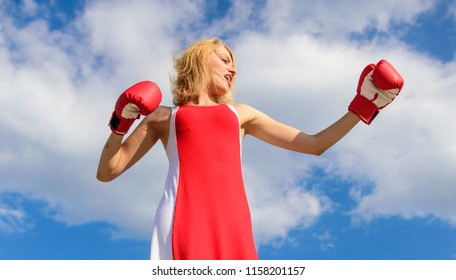 Lady fighter defend her point. Satisfied free girl boxing gloves. Femininity and strength balance. Woman red dress and boxing gloves enjoy victory. She fighter female rights. Assert her point of view.
