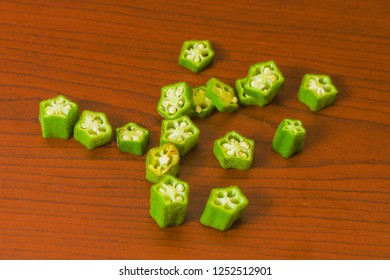 lady finger okra pieces slices food green fresh organic closeup on isolated background