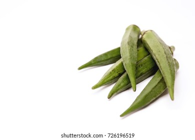 Lady Fingers or Okra. White isolated background. Space for text.