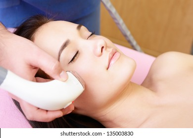 lady getting electrostimulation lifting therapy, beautiful face of young woman and rejuvenated treatment