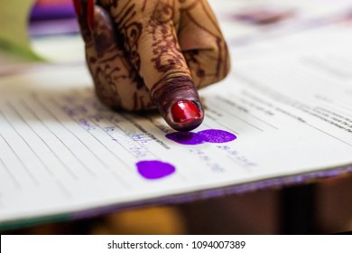 lady giving thumb impression on marriage registry certificate. Indian matrimony. Bengali weddding