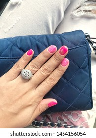 The Lady with glamorous shocking pink nail