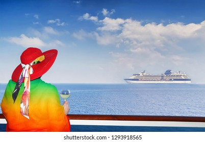 Lady with a glass of wine looking on cruise ship sailing from port