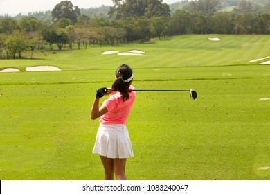 Lady golfer by the golf courses