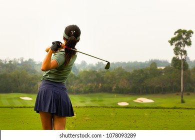 Lady golfer are finished golf swing on golf course, ladies golfer, golf swinging.