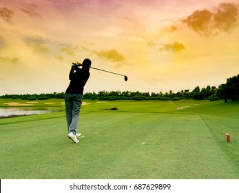 Lady golfer, girl golf player hit the golf ball with full swing, follow through on the tee at sunrise beautiful golf course