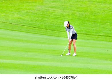 Lady golfer, lady golfer setup golf swing on the fairway.