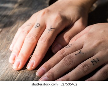 The lady hand with alphabet tattoo,small tattoo