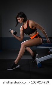 Lady Hand lift up dumbbell one hand at Gym for bodybuilder. in Seated Dumbbell Concentration Curls Action. Halthy concept.