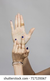 lady hands wearing bracelet and ring
