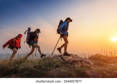 Lady hikers walking in the mountains.