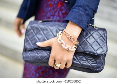lady holding black leather pouch