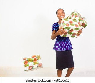 Lady holding gift boxes