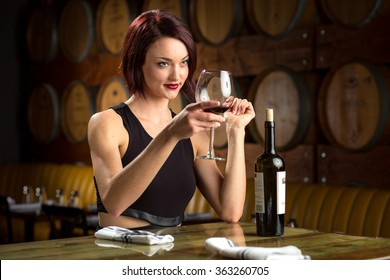 Lady holds glass of wine for cheers toast at a dinner party winery vineyard classy