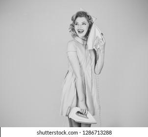 Lady Ironing - Retro woman hold iron as phone on grey background