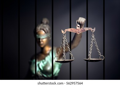 Lady Justice against jail background