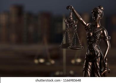 Lady justice. Dark background.
