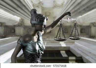 Lady Justice isolated on Front Columns of the Supreme Court of U.S. background