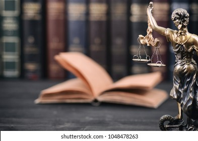 Lady Justice, law library concept, Law books in the background.