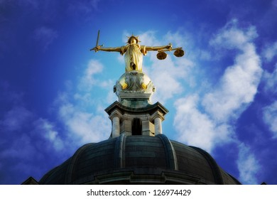 Lady Justice on top of the Old Bailey in London, England, processed with a Lomo style effect.