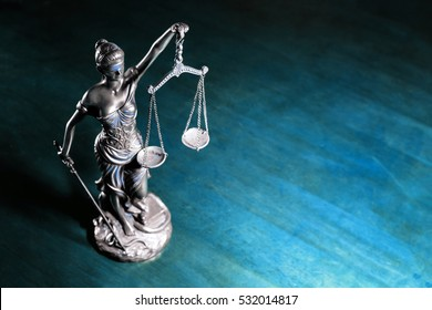 Lady Justice on wooden table (Blue tone)