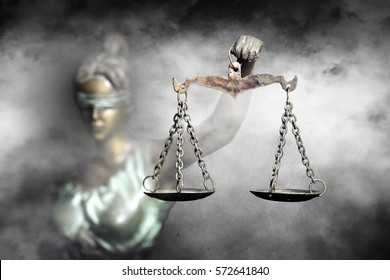 Lady Justice raising the Scale of justice through fog (Concept of hope in justice)