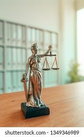 Lady Justice statue in law firm attorney office, blindfolded Justitia with balance scales and sword is personification of moral force in judicial system