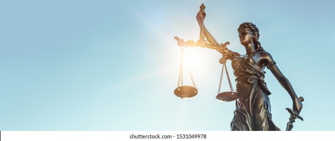 Lady justice. Statue of Justice on sky background. Legal and law concept