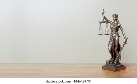 Lady Justice Statue on a table. Panoramic image with copy space.