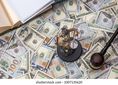 Lady justice or  themis, book and gavel on dollar bills