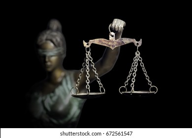 Lady Justice or Themis (God of Justice) isolated on black background