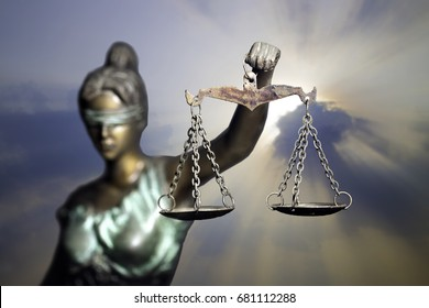 Lady Justice or Themis (God of Justice) on sunlight background