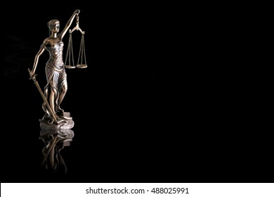 Lady justice or Themis with reflection isolated on black background and space for text