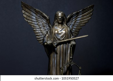 Lady justice or Themis (Symbol of justice) on black background