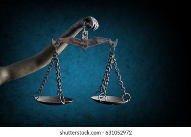 Lady Justice's and holding Scale of Justice isolated on grunge blue background