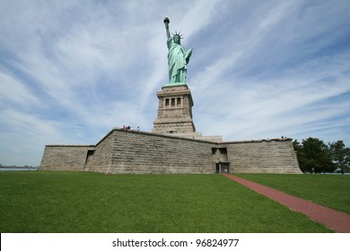 Lady Liberty with the background sky in a radiating pattern. Statue of Liberty.