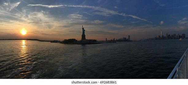 Lady liberty at sunset