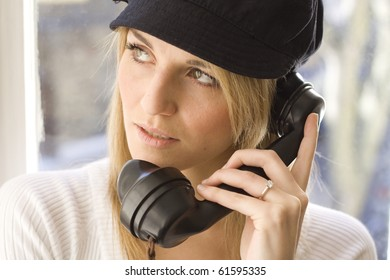 Lady listening on old telephone