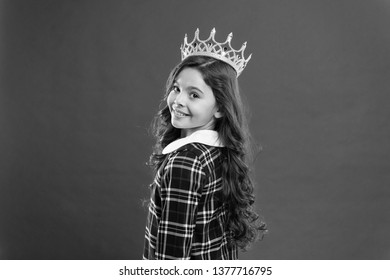 Lady little princess. Girl wear crown red background. Spoiled child concept. Egocentric princess. World spinning around me. Kid wear golden crown symbol princess. Every girl dreaming become princess.