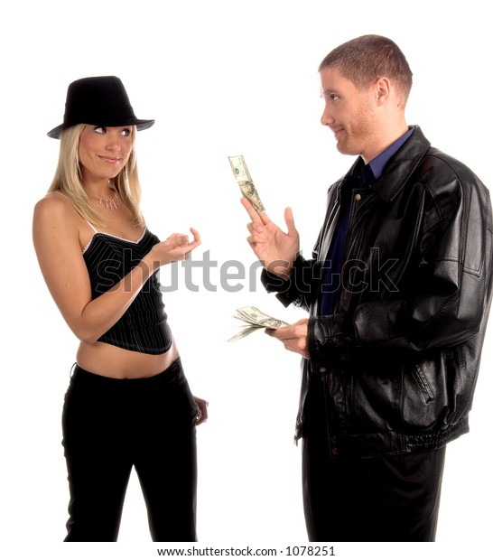 Lady luck in the form of a beautiful and sexy young blonde in a pinstripe hat and corsette top collects her fee from the casino winnings of a man