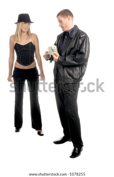 Lady luck in the form of a beautiful and sexy young blonde l in a pinstripe hat and corsette top collects her fee from the casino winnings of a man