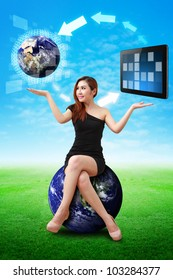 Lady on globe hold the world and touch pad : Elements of this image furnished by NASA