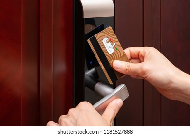 lady opening an electronic door lock by a security card
