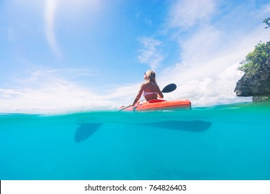 Lady paddling the kayak in the calm tropical bay with blue sky on background. Split photo. Selective focus.