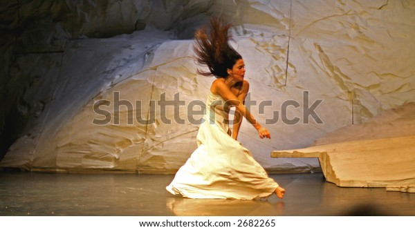 lady performing dance on stage during the pina bausch performance